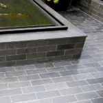 Grey Basalt Exterior Floor & Fishpond in Honed